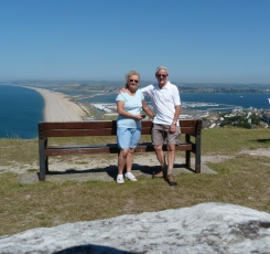 John & Jan Love at Portland overlooking Chesil Beach
