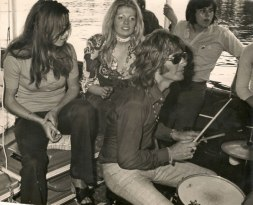 Alan playing drums on a river boat gig