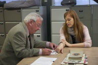 Rod Dengate with Lucy Allen, completing the accession form covering all the material handed over today.