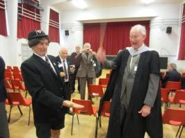 Adrian Appley receives whacks from History master Tony Bradley