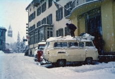 Clearing snow from the van roof at Hotel Silverplanner