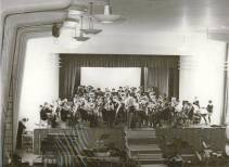 This longer shot, taken in the Cray Valley School Assembly Hall, shows the combined Cray Valley an Ringmer Band at rehearsal. Does anyone know what is happening at the table in the bottom left of the photograph? Could it be the reel-to-reel tape recorder sometimes borrowed from the Borough Music Director's (Roy Smith) office to record school performances and transfer them to LPs?